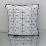 Coussin géométrique noir et blanc